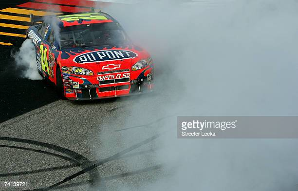 Jeff Gordon, driver of the DuPont Chevrolet, does a burnout after winning the NASCAR Nextel Cup Series Dodge Avenger 500 on May 13, 2007 at...