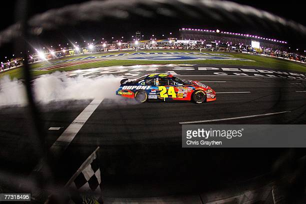 Jeff Gordon driver of the DuPont Chevrolet does a victory burnout after winning the NASCAR Nextel Cup Series Bank of America 500 at Lowe's Motor...
