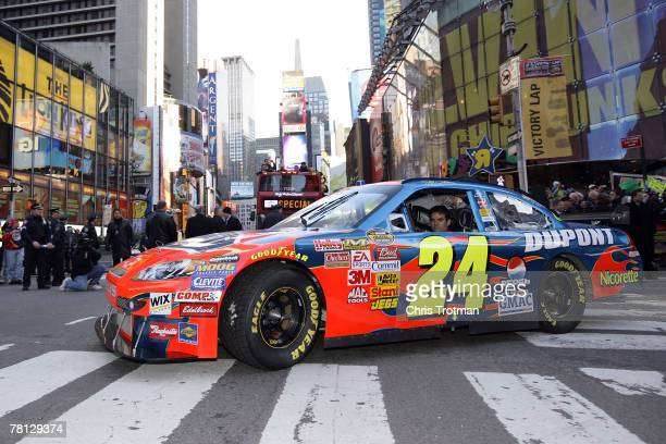 Jeff Gordon, driver of the DuPont Chevrolet, drives down 7th Ave towards Time Square in a victory lap through the streets of Midtown during NASCAR...