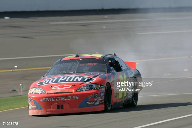 Jeff Gordon driver of the DuPont Chevrolet drives down pit road towards victory lane after winning the NASCAR Nextel Cup Series Aaron's 499 at...
