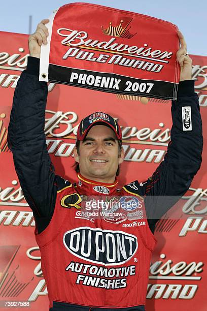 Jeff Gordon, driver of the DuPont Chevrolet, holds up the bud pole award flag after qualifying first for the NASCAR Nextel Cup Series Subway Fresh...