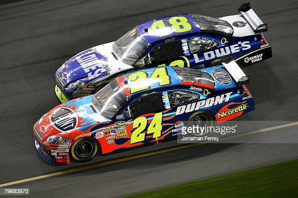 Jeff Gordon driver of the Dupont Chevrolet leads Jimmie Johnson driver of the Lowe's Chevrolet during the Budweiser Shootout at Daytona International...