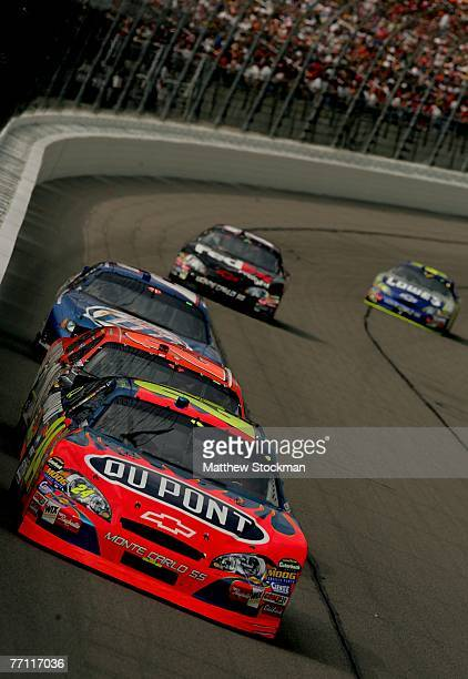 Jeff Gordon, driver of the Dupont Chevrolet, leads Tony Stewart, driver of the The Home Depot Chevrolet, Kurt Busch, driver of the Miller Lite Dodge,...