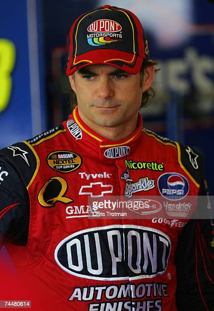 Jeff Gordon driver of the DuPont Chevrolet looks on in the garage during practice for the NASCAR Nextel Cup Series Pocono 500 at Pocono Raceway on...
