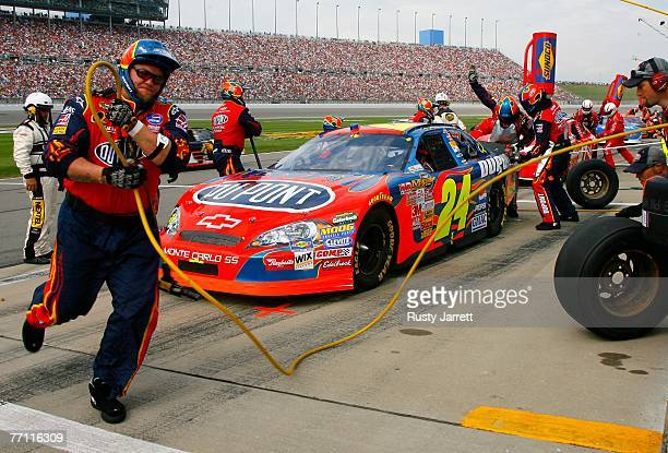 Jeff Gordon, driver of the Dupont Chevrolet, makes a pit stop during the NASCAR Nextel Cup Series LifeLock 400 at Kansas Speedway on September 30,...