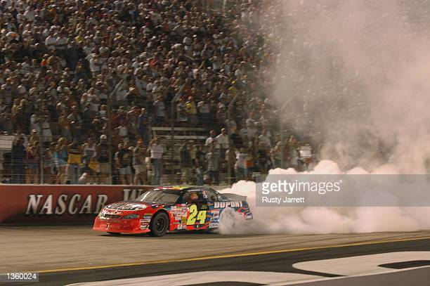Jeff Gordon driver of the Dupont Chevrolet Monte Carlo after winning the NASCAR Winston Cup Series Sharpie 500 on August 23 2002 at Bristol Motor...