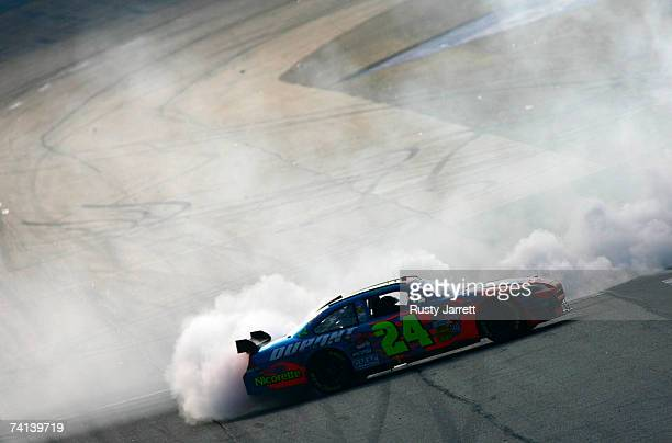 Jeff Gordon, driver of the DuPont Chevrolet, performs a burnout on the track after winning the NASCAR Nextel Cup Series Dodge Avenger 500 on May 13,...