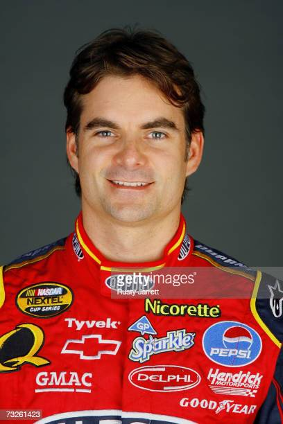 Jeff Gordon driver of the Dupont Chevrolet poses during the NASCAR media day at Daytona International Speedway on February 8 2007 in Daytona Florida