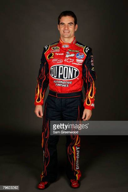 Jeff Gordon, driver of the DuPont Chevrolet, poses for a photo during the NASCAR Sprint Cup Series media day at Daytona International Speedway on...