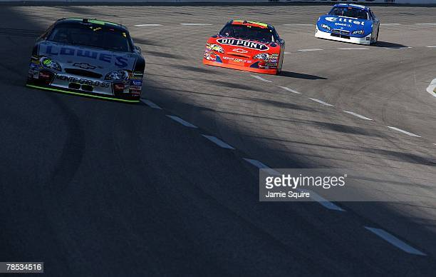 Jeff Gordon driver of the DuPont Chevrolet races after Jimmie Johnson driver of the Lowe's / Kobalt Tools Chevrolet during the NASCAR Nextel Cup...