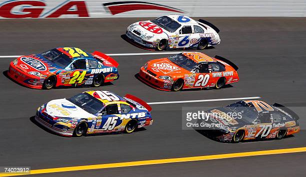 Jeff Gordon driver of the DuPont Chevrolet races against Kyle Petty driver of the National Tire Battery Dodge Tony Stewart driver of the The Home...