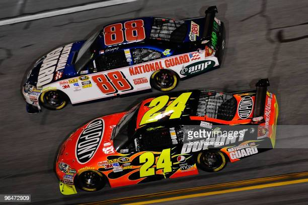 Jeff Gordon driver of the Dupont Chevrolet races Dale Earnhardt Jr driver of the National Guard Chevrolet during the Budweiser Shootout at Daytona...
