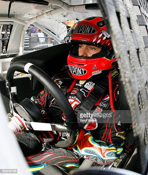 Jeff Gordon, driver of the DuPont Chevrolet, sits in his car prior to practice for the NASCAR Sprint Cup Series Auto Club 500 at Auto Club Speedway...