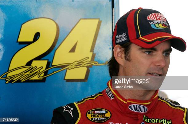 Jeff Gordon, driver of the DuPont Chevrolet, stands in the garage area during practice for the NASCAR Nextel Cup Series Dodge Avenger 500 on May 11,...