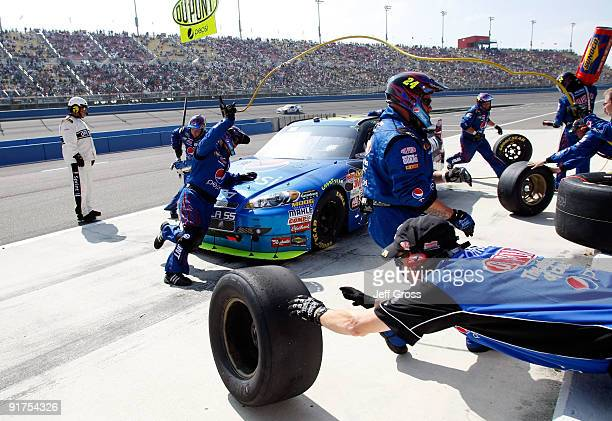 Jeff Gordon driver of the DuPont/Pepsi Chevrolet comes in for a pit stop during the NASCAR Sprint Cup Series Pepsi 500 at Auto Club Speedway on...