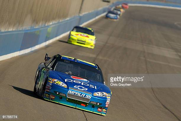 Jeff Gordon driver of the DuPont/Pepsi Chevrolet races during the NASCAR Sprint Cup Series Pepsi 500 at Auto Club Speedway on October 11 2009 in...