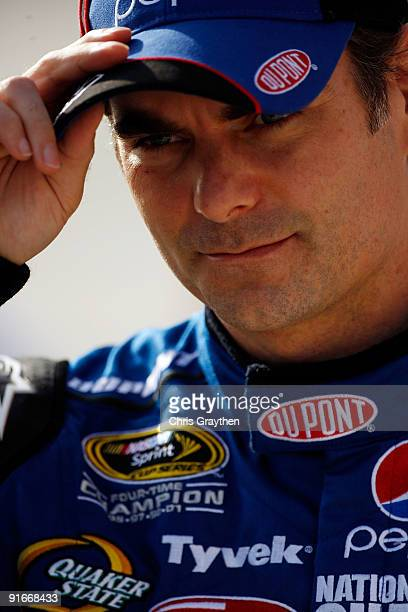 Jeff Gordon driver of the DuPont/Pepsi Chevrolet stands on pit road during qualifying for the NASCAR Sprint Cup Series Pepsi 500 at Auto Club...