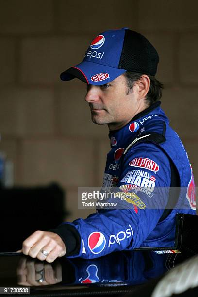 Jeff Gordon driver of the DuPont/Pepsi Chevrolet waits in the garage during practice for the NASCAR Sprint Cup Series Pepsi 500 at Auto Club Speedway...