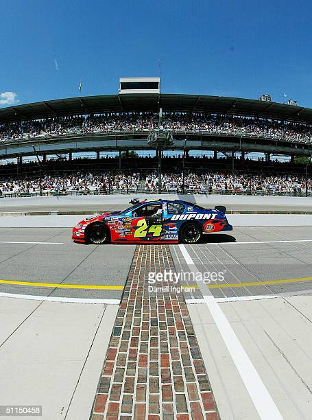 Jeff Gordon driver of the Hendrick Motorsport DuPont Chevrolet crossesthe famed yard of bricks during practice for the NASCAR Nextel Cup Series...