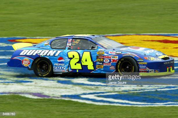Jeff Gordon, driver of the Hendrick Motorsports Chevrolet, spins out in the infield after winning the Aaron's 499 on April 25, 2004 at the Talladega...