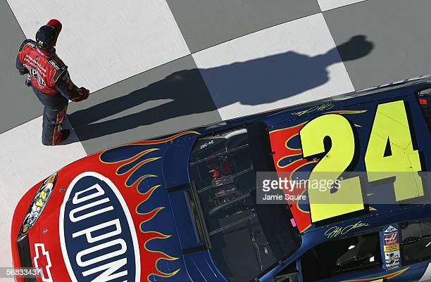 Jeff Gordon driver of the Hendrick Motorsports Chevrolet walks into Victory Lane after qualifying on the front row for the NASCAR Nextel Cup Daytona...