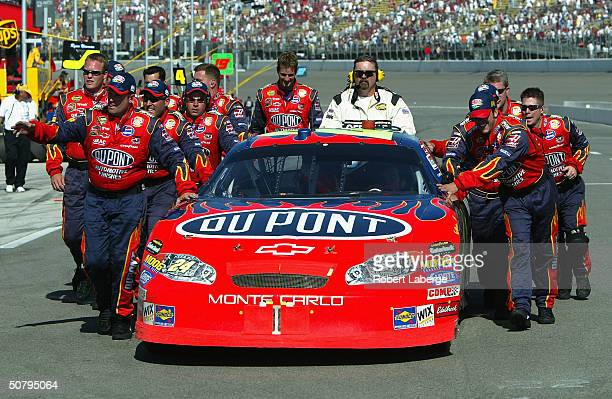 Jeff Gordon driver of the Hendrick Motorsports DuPont Chevrolet is pushed to victory lane by his team after running out of gas and winning the NASCAR...