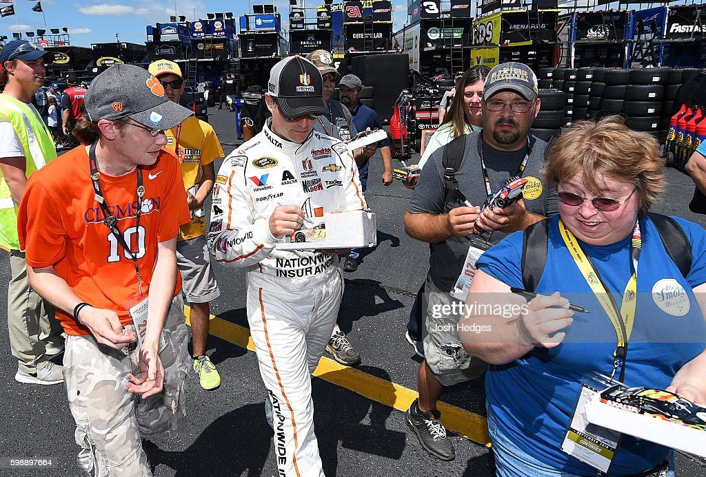 Jeff Gordon, driver of the #88 Nationwide Chevrolet, signs autographs during practice for the NASCAR Sprint Cup Series Bojangles' Southern 500 at Darlington Raceway on September 3, 2016 in Darlington, South Carolina.