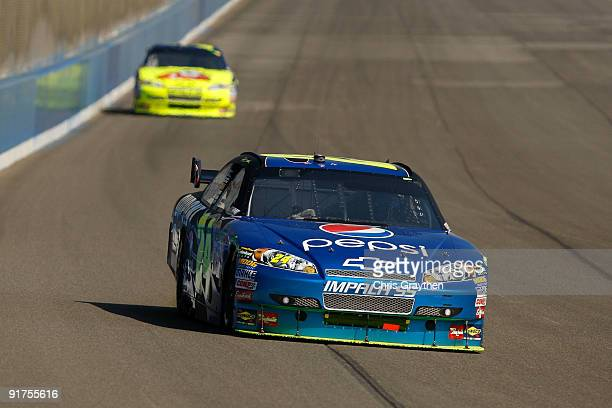 Jeff Gordon driver of the Pepsi Chevrolet leads teammate Mark Martin driver of the Kellogg's Chevrolet during the NASCAR Sprint Cup Series Pepsi 500...