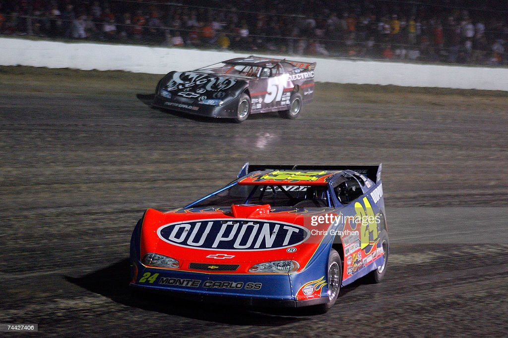 Jeff Gordon drives the #24 car in front of Kyle Busch #51 during the Nextel Prelude to the Dream on June 6, 2007 at Eldora Speedway in New Weston, Ohio.