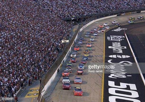 Jeff Gordon drives the Dupont Chevrolet at the start of the NASCAR Nextel Cup series Sharpie 500 on August 28 2004 at Bristol Motor Speedway in...