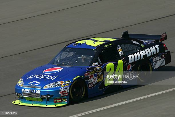 Jeff Gordon drives the DuPont/Pepsi Chevrolet during practice for the NASCAR Sprint Cup Series Pepsi 500 at Auto Club Speedway on October 9 2009 in...