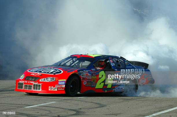 Jeff Gordon driving his Hendrick Motorsports Dupont Chevrolet does donuts and smokes his tires on the front stretch after winning the NASCAR Winston...