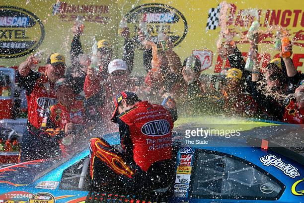 Jeff Gordon gets bathed in water and Gatorade after winning the Dodge Avenger 500 at Darlington Raceway in Darlington, South Carolina, Sunday, May...