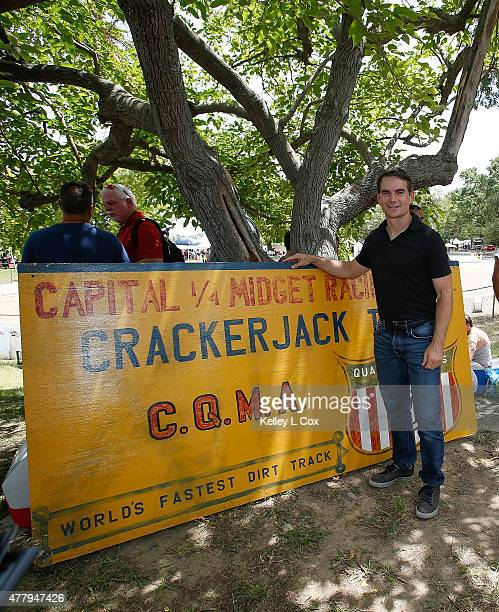 Jeff Gordon in from of the CrackerJack Track sign at the Capitol Quarter Midget Association Dirt Track on June 20 2015 in Rio Linda California