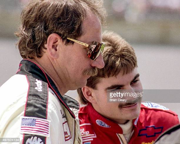 Jeff Gordon in the rookie year of his NASCAR career talks with Dale Earnhardt Sr at Daytona International Speedway circa July 1993 in Daytona Beach...