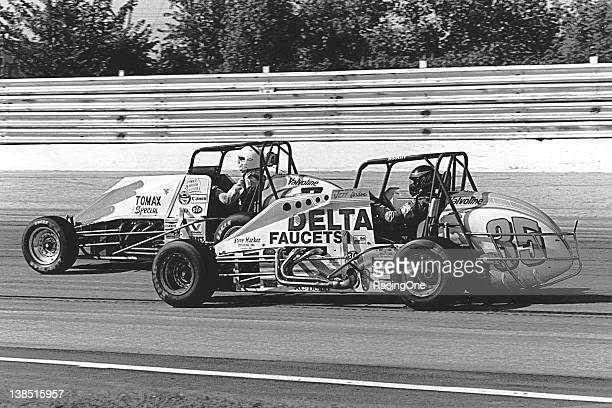 Jeff Gordon makes an inside move on Mark Alderson during a USAC Silver Crown Series race at the Milwaukee Mile