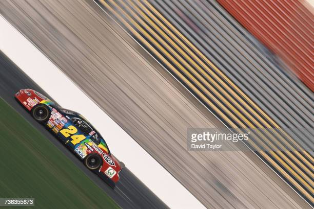 Jeff Gordon of the United States drives the DuPont Refinishes Hendrick Motorsports Chevrolet Monte Carlo during practice for the NASCAR Winston Cup...