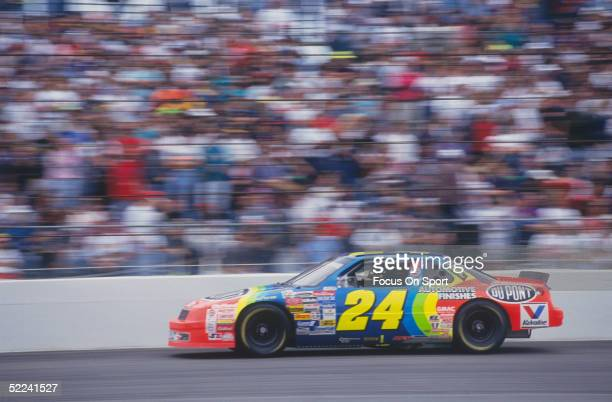 Jeff Gordon races in his Dupont car during the Daytona 500 at the Daytona Speedway on February 14 1993 in Daytona Beach Florida