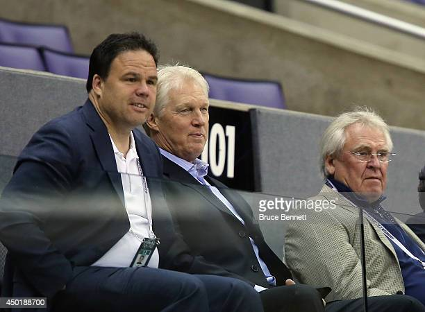 Jeff Gorton Jim Schoenfled and Glen Sather of the New York Rangers watch a practice session on an off day during the 2014 NHL Stanley Cup playoffs at...