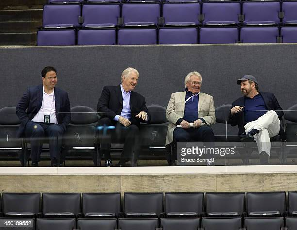 Jeff Gorton Jim Schoenfled Glen Sather and James Dolan of the New York Rangers watch a practice session on an off day during the 2014 NHL Stanley Cup...