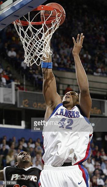 Jeff Graves of the Kansas Jayhawks goes up for two as David Doubley of the Pacific Tigers defends during the second round game of the NCAA Division I...