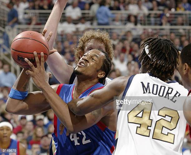 Jeff Graves of the Kansas Jayhawks is fouled by Clarence Moore of the Georgia Tech Yellow Jackets during the fourth round game of the NCAA Division I...