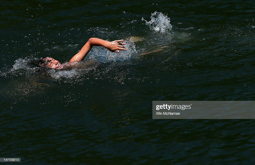 Jeff Grayson swims in the quarry lake at the Beaver Dam Swimming
