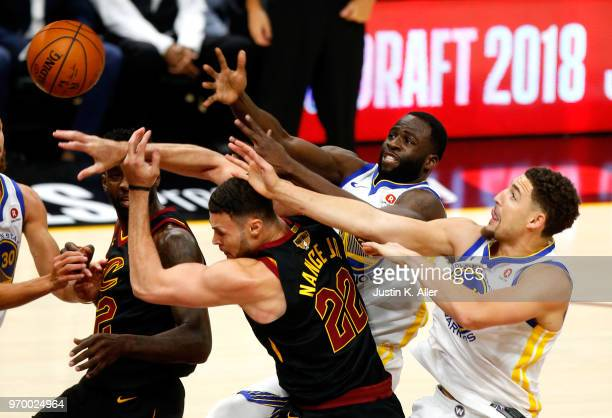 Jeff Green and Larry Nance Jr #22 of the Cleveland Cavaliers compete for the ball with Draymond Green and Klay Thompson of the Golden State Warriors...