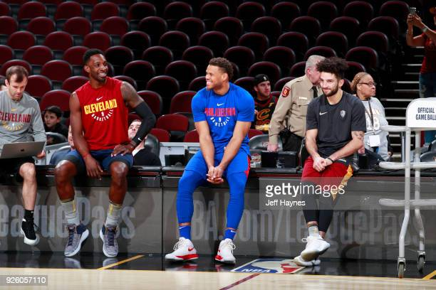Jeff Green and London Perrantes of the Cleveland Cavaliers speak with Justin Anderson of the Philadelphia 76ers before the game on March 1 2018 at...
