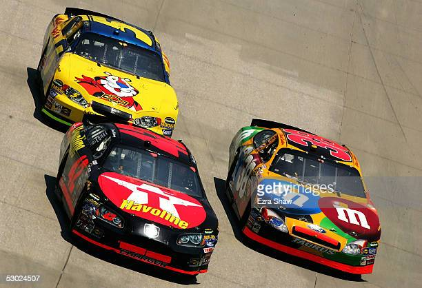 Jeff Green driver of the Cheerios/Betty Crocker Dodge car Jamie McMurray driver of the Texaco/Haoline Chip Ganassi Racing Dodge car and Kyle Busch...