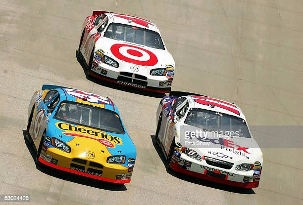 Jeff Green driver of the Cheerios/Betty Crocker Dodge car Jason Leffler driver of the FedEx Freight Chevrolet car and Casey Mears driver of the...