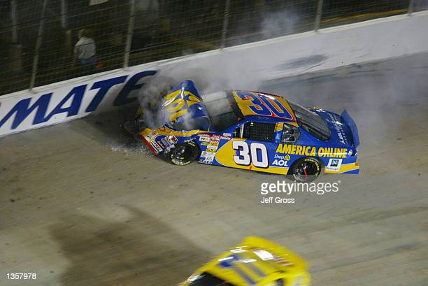 Jeff Green driver of the Chevrolet Monte Carlo crashes into the wall between turns three and four during the NASCAR Winston Cup Series Sharpie 500 on...