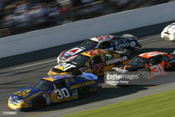 Jeff Green driving the America Online Chevrolet dices with Ward Burton's Bill Davis Racing Dodge Intrepid Jeff Burton's CITGO Racing Ford and Robby...