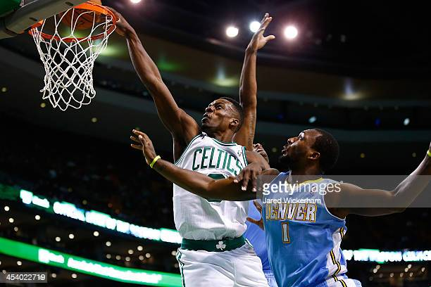 Jeff Green of the Boston Celtics attempts a dunk in front of Jordan Hamilton of the Denver Nuggets in the first quarter during the game at TD Garden...